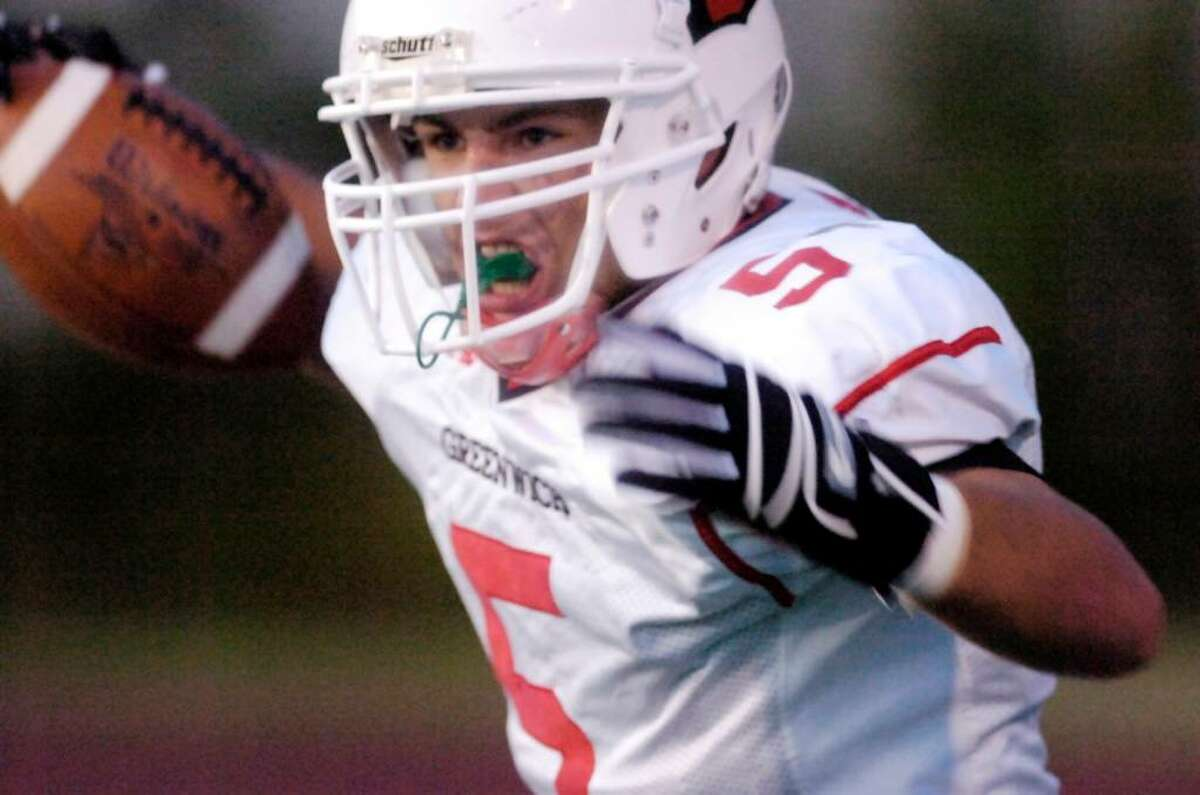 Greenwich High's P.J. Schwabe reacts after scoring for the Cardinals during first half action as the Stamford Black Knights host the Greenwich Cardinals in a football game. Keelin Daly