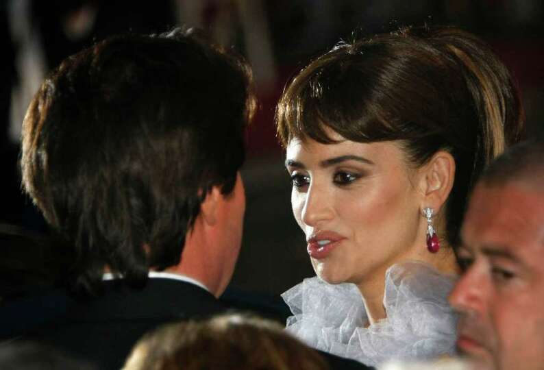 Director Rob Marshall speaks with actress Penelope Cruz after the screening of Pirates of the Caribb