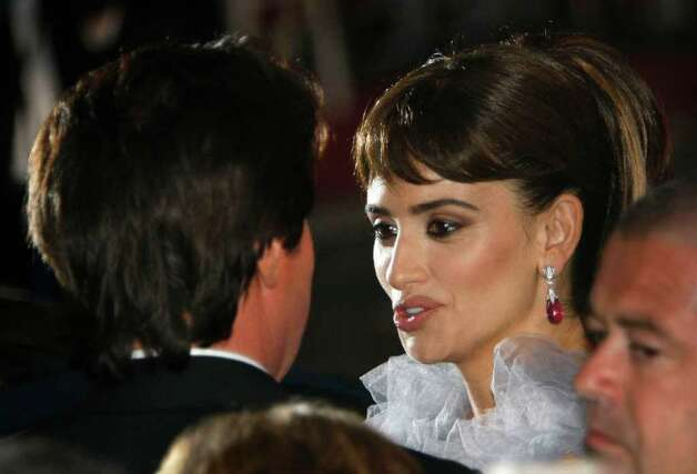 Director Rob Marshall speaks with actress Penelope Cruz after the screening of Pirates of the Caribbean: On Stranger Tidesat the 64th international film festival, in Cannes, southern France, Saturday, May 14, 2011. Photo: AP