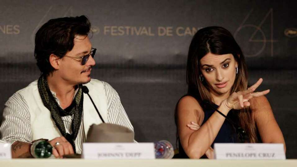 Actors Johnny Depp and Penelope Cruz attend a press conference for Pirates of the Caribbean: On Stra