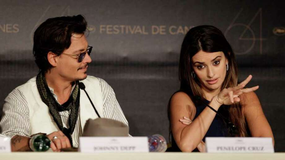 Actors Johnny Depp and Penelope Cruz attend a press conference for Pirates of the Caribbean: On Stranger Tides at the 64th international film festival, in Cannes, southern France, Saturday, May 14, 2011. Photo: AP
