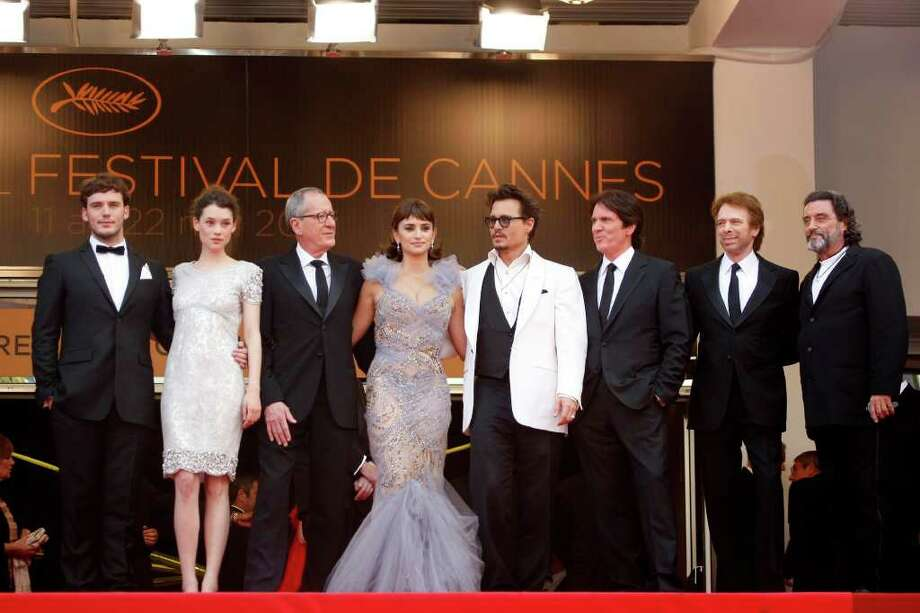 Director Rob Marshall, third right, and producer Jerry Bruckheimer, second right, arrive with actors from left, Sam Claflin, Astrid Berges-Frisbey, Geoffrey Rush, Penelope Cruz, Johnny Depp, Ian McShane for the screening of Pirates of the Caribbean: On Stranger Tides, at the 64th international film festival, in Cannes, southern France, Saturday, May 14, 2011. Photo: AP