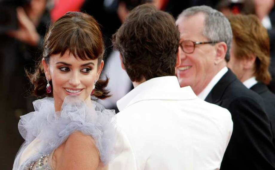 From left, actors Penelope Cruz, Johnny Depp and Geoffrey Rush arrive for the screening of Pirates of the Caribbean: On Stranger Tides, at the 64th international film festival, in Cannes, southern France, Saturday, May 14, 2011. Photo: AP