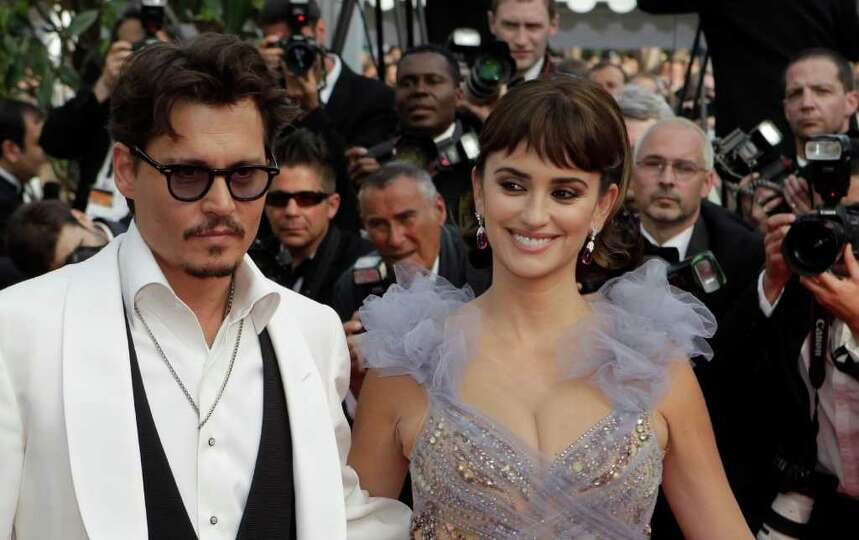 Actors Johnny Depp and Penelope Cruz arrive for the screening of Pirates of the Caribbean: On Strang