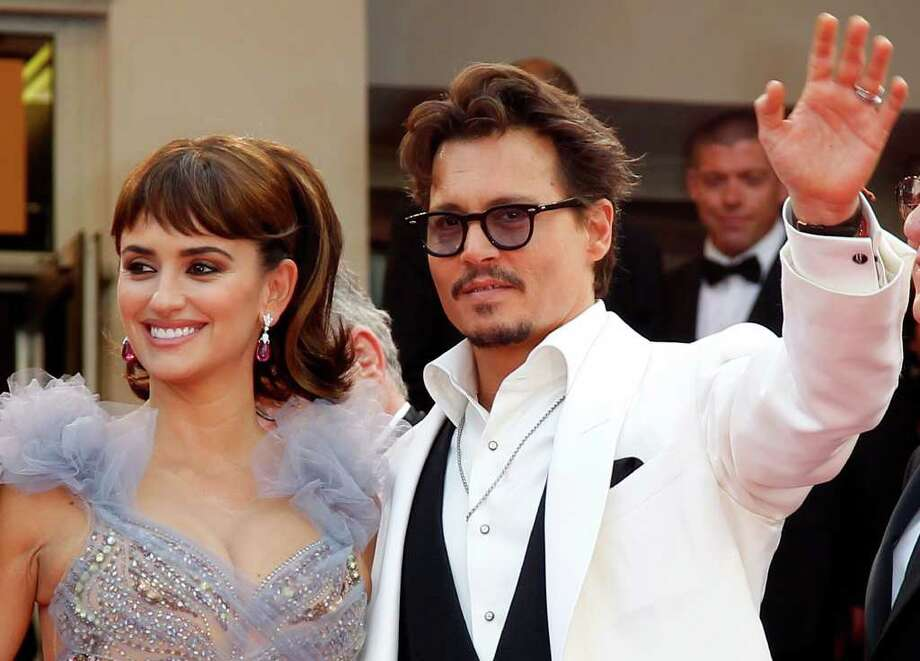 Actors Penelope Cruz, left, and Johnny Depp pose on the red carpet for the screening of Pirates of the Caribbean: On Stranger Tides, at the 64th international film festival, in Cannes, southern France, Saturday, May 14, 2011. Photo: AP