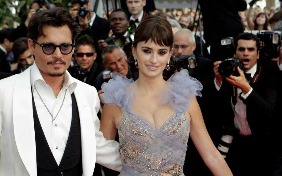 Actors Johnny Depp and Penelope Cruz arrive for the screening of Pirates of the Caribbean: On Stranger Tides, at the 64th international film festival, in Cannes, southern France, Saturday, May 14, 2011. Photo: AP