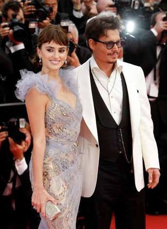 Actors Penelope Cruz, left, and Johnny Depp arrive for the screening of Pirates of the Caribbean: On Stranger Tides, at the 64th international film festival, in Cannes, southern France, Saturday, May 14, 2011. Photo: AP