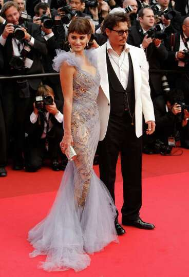 Actors Penelope Cruz, left, and Johnny Depp arrive for the screening of Pirates of the Caribbean: On