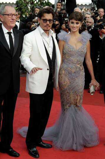 From left, actors Geoffrey Rush, Johnny Depp and Penelope Cruz arrive for the screening of Pirates o