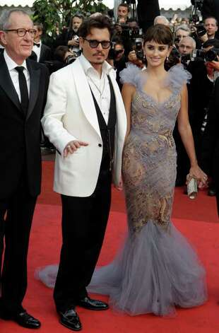 From left, actors Geoffrey Rush, Johnny Depp and Penelope Cruz arrive for the screening of Pirates of the Caribbean: On Stranger Tides, at the 64th international film festival, in Cannes, southern France, Saturday, May 14, 2011. Photo: AP