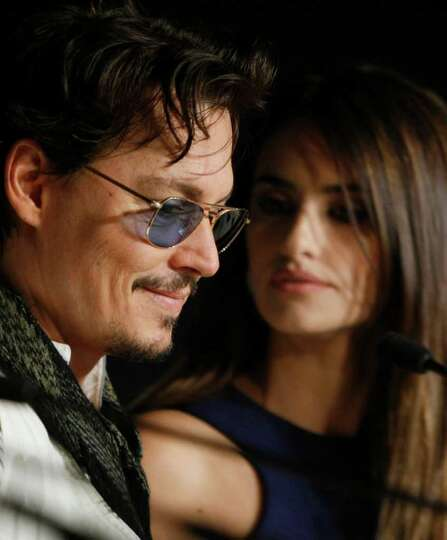 Actor Johnny Depp, left, and Penelope Cruz attend a press conference for Pirates of the Caribbean: O