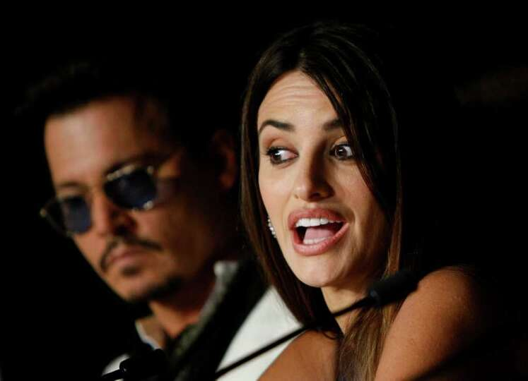 Actors Johnny Depp, left, and Penelope Cruz attend a press conference for Pirates of the Caribbean: