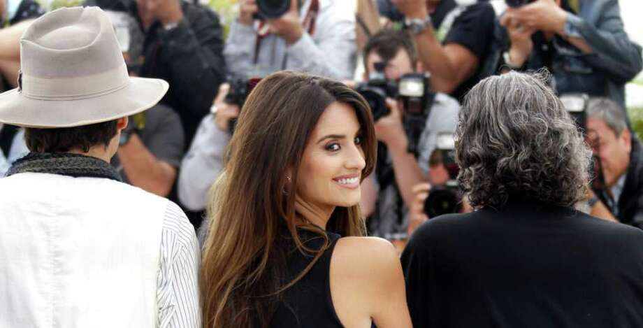 Actress Penelope Cruz, centre, poses during a photo call for Pirates of the Caribbean: On Stranger Tides at the 64th international film festival, in Cannes, southern France, Saturday, May 14, 2011. Photo: AP
