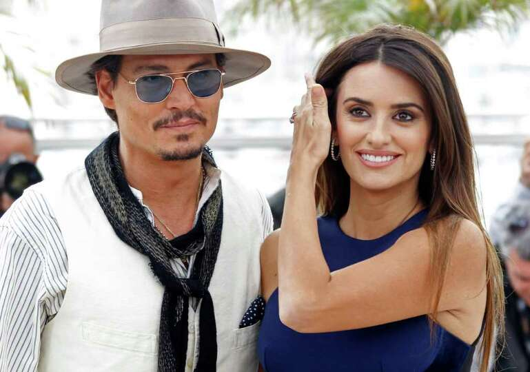Actors Johnny Depp and Penelope Cruz pose during a photo call for Pirates of the Caribbean: On Stran