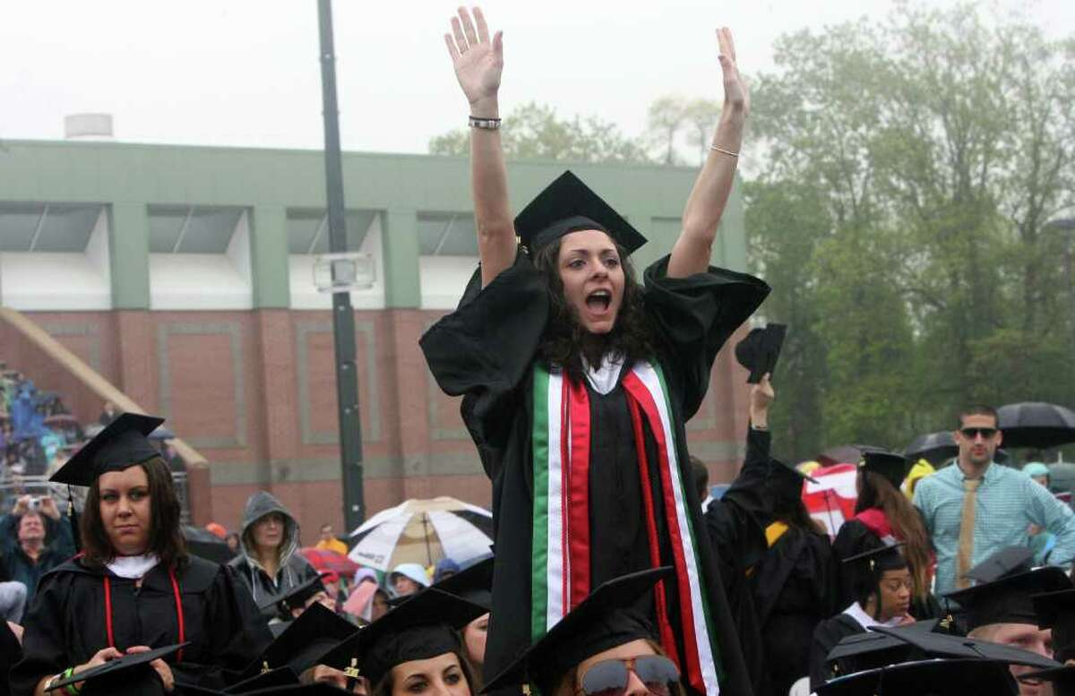 Mari Brown , of MA, cheers on friends during the SHU Commencement ceremony on Sunday, May 15, 2011.