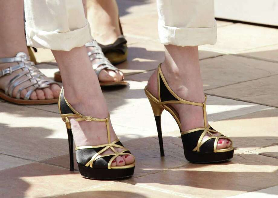 """MAY 16:  Actress Alice Barnole (shoe detail) attends the """"L'Apollonide"""" photocall during the 64th Annual Cannes Film Festival at Palais des Festivals on Monday in Cannes, France. Photo: Vittorio Zunino Celotto, Getty Images / 2011 Getty Images"""