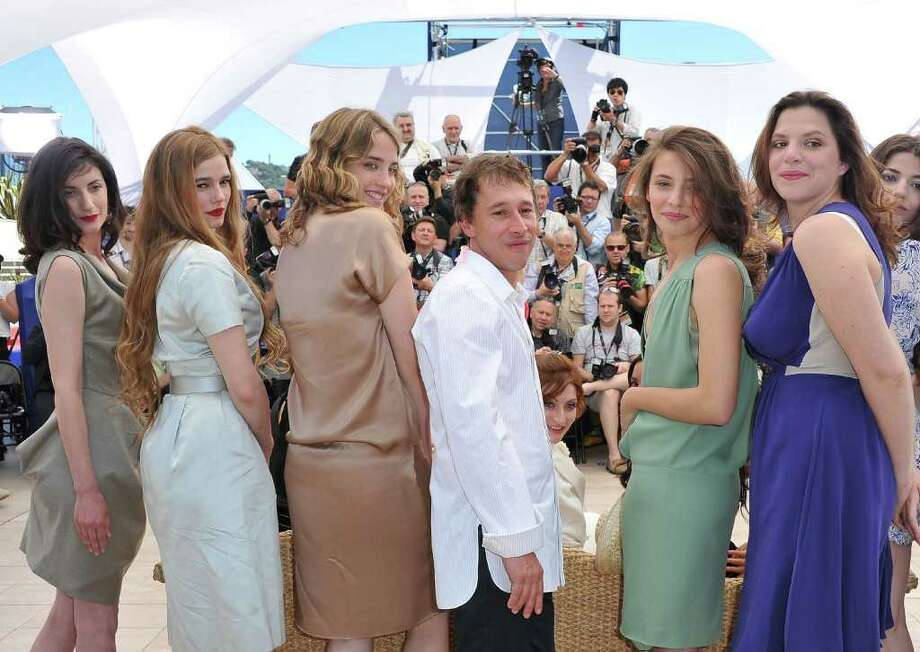 ":  (L - R) Actresses Judith Lou Levy, Pauline Jacquard, Adele Haenel, Director Bertrand Bonello, Jasmine Trinca and Maia Sandoz attend the ""L'Apollonide"" photocall during the 64th Annual Cannes Film Festival at Palais des Festivals on Monday in Cannes, France. Photo: Pascal Le Segretain, Getty Images / 2011 Getty Images"
