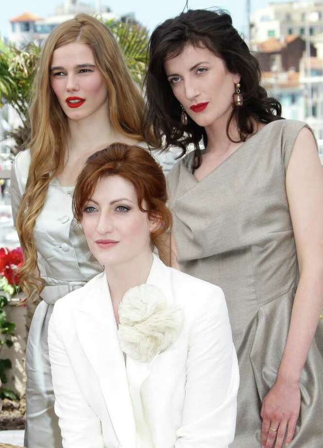 """Actresses Pauline Jacquard, Alice Barnole and Judith Lou Levy attend the """"L'Apollonide"""" photocall during the 64th Annual Cannes Film Festival at Palais des Festivals on Monday. Photo: Vittorio Zunino Celotto, Getty Images / 2011 Getty Images"""