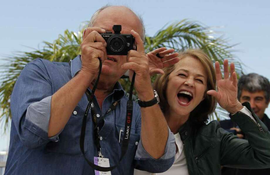 "British actress Charlotte Rampling poses behind German photographer Peter Lindbergh as he takes a picture during the photocall of ""The Look"" presented in the Cannes Classics selection at the 64th Cannes Film Festival on Monday in Cannes.   AFP PHOTO / FRANCOIS GUILLOT Photo: FRANCOIS GUILLOT, AFP/Getty Images / 2011 AFP"