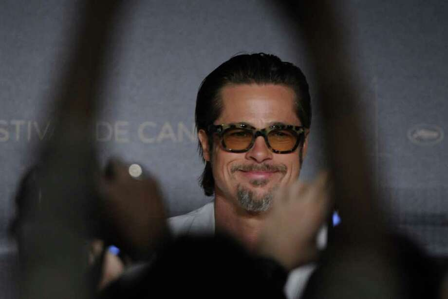 "Brad Pitt attends the press conference of ""The Tree of Life"" presented in competition at the 64th Cannes Film Festival on Monday.   AFP PHOTO / ANNE-CHRISTINE POUJOULAT Photo: ANNE-CHRISTINE POUJOULAT, AFP/Getty Images / 2011 AFP"