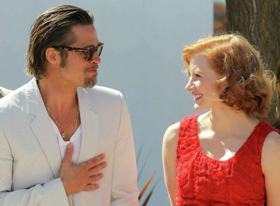 "Brad Pitt and Jessica Chastain arrive for the photocall of ""The Tree of Life"" presented in competition at the 64th Cannes Film Festival on Monday in Cannes.  AFP PHOTO / VALERY HACHE Photo: VALERY HACHE, AFP/Getty Images / 2011 AFP"