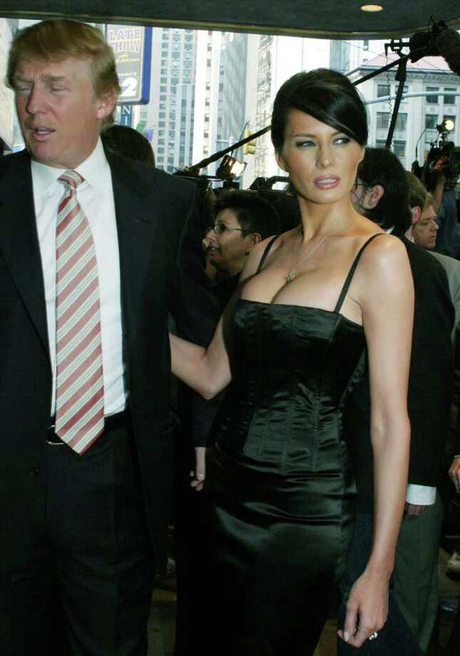 "Billionaire developer Donald Trump and model Melania Knauss arrive at the opening night performance of ""Bombay Dreams"" at the Broadway Theatre Thursday, April 29, 2004 in New York. The pair were engaged on Monday. Photo: TINA FINEBERG, AP / AP"