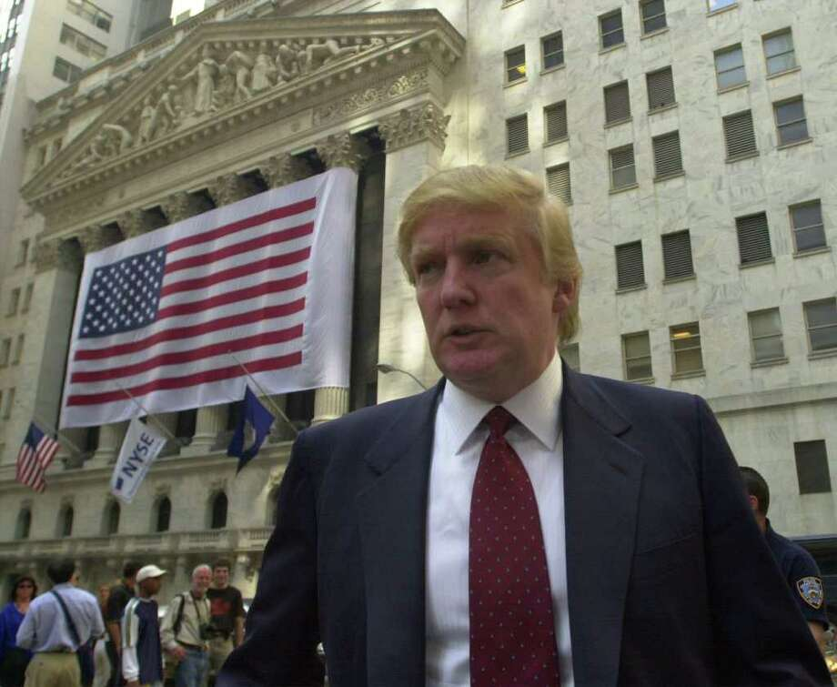 Donald Trump walks past the New York Stock Exchange in New York's financial district Tuesday, Sept. 18, 2001. Photo: EDWARD A. ORNELAS, AP / SAN ANTONIO EXPRESS-NEWS