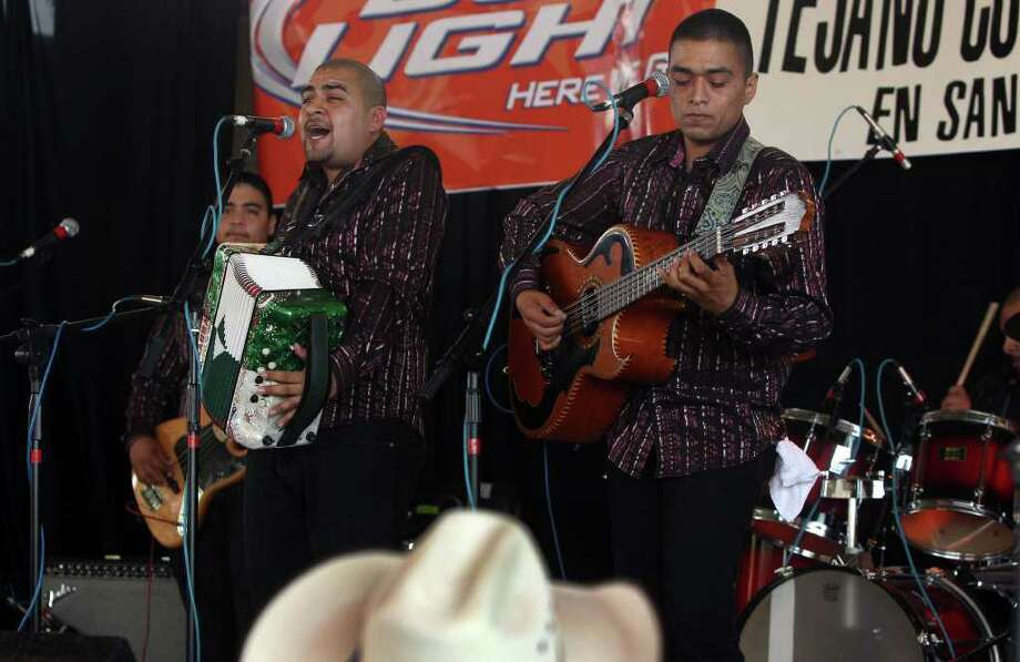 Salomon (cq) Ramos plays the accordion leading Grupo Retono Sunday May 15, 2011 at Rosedale Park during the last day of the Tejano Conjunto Festival. On the right playing the bajo sexto is Samuel Ramos. The festival started last Thursday. JOHN DAVENPORT/jdavenport@express-news.net Photo: SAN ANTONIO EXPRESS-NEWS