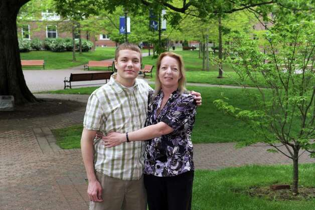 Kevin Busch, 22, and his mother, Susan Donnelly, 46, of Danbury, will both be graduating from Western Connecticut State University Sunday. Photo taken Monday, May 16, 2011. Photo: Carol Kaliff / The News-Times