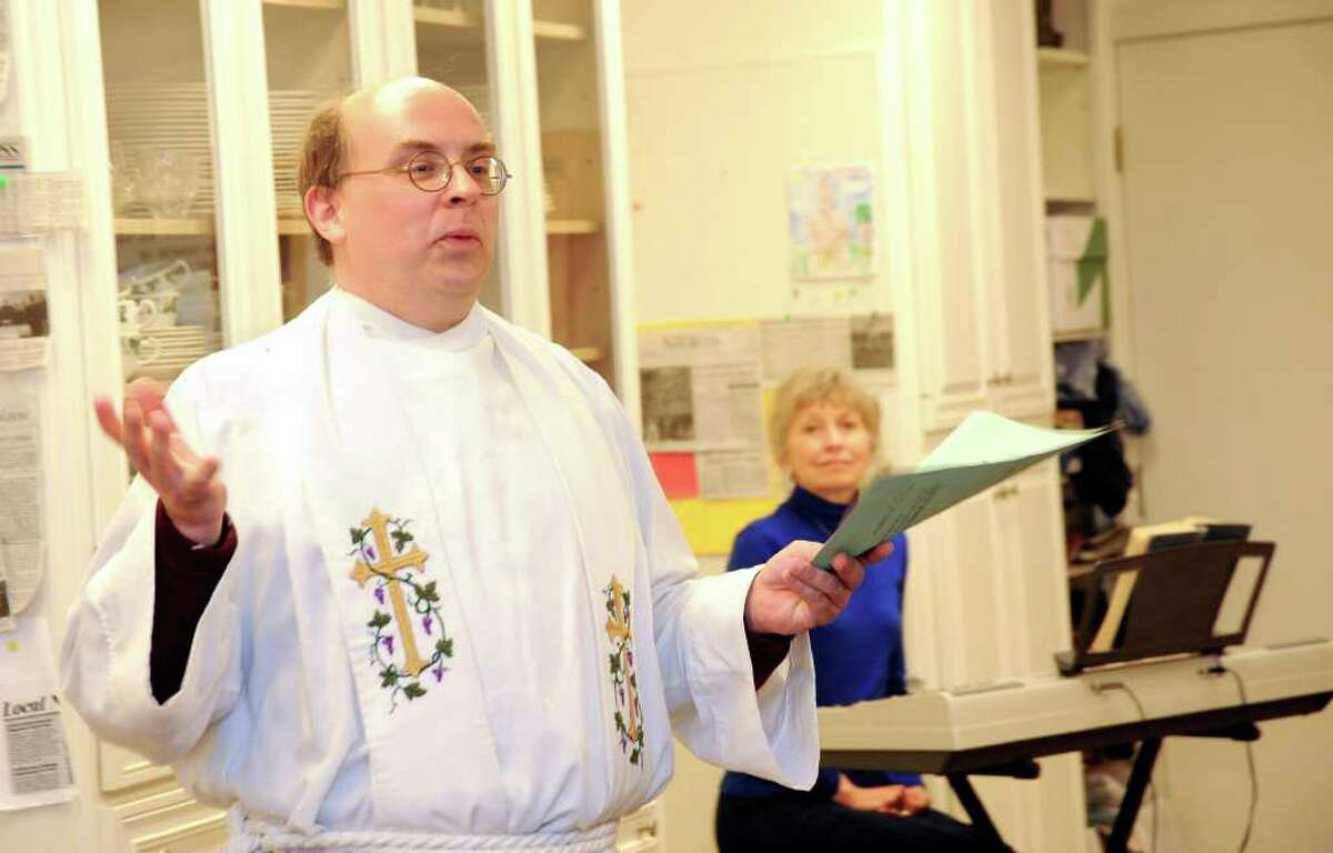 The Rev. John David Heeckt of the Ridgebury Congregational Church in Ridgefield conducts a service at the Blessing of the Animals with organist Jean Early. Photo taken Sunday, may 15, 2011.