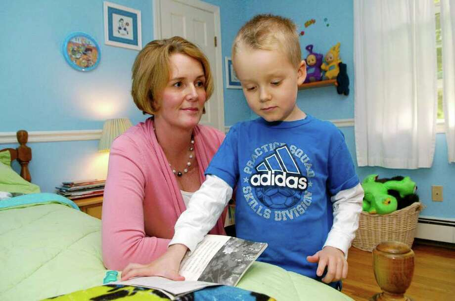 Lisa Rankin and her 5 year old son Matthew at home in Stamford, Conn. on Monday May 16, 2011. Matthew  has eosophilinic esophagitis, a disease that causes white blood cells to attack the esophagus. Photo: Dru Nadler / Stamford Advocate Freelance