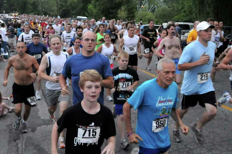 The start of last June's Moonlight Run 5K run in New Milford. Photo: Lisa Weir / The News-Times Freelance
