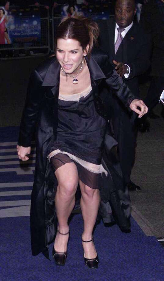 """When you live life in front of cameras, the world's going to see your stumbles, as many an actor, model and politician knows. Here, actress Sandra Bullock trips as she arrives for the  premiere of her film """"Miss Congeniality"""" at the Odeon, West End on March  19, 2001 in London. Guess she wasn't watching her blind side. Photo: Dave Hogan, Getty Images / 2001 Getty Images"""