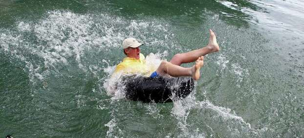 In 2010, Larry Hammonds, Chamber of Commerce Chair of the Board,  splashes into the water as New Braunfels leaders mark the opening of the  Comal River. (File photo) Photo: TOM REEL, SAN ANTONIO EXPRESS-NEWS / © 2010 San Antonio Express-News