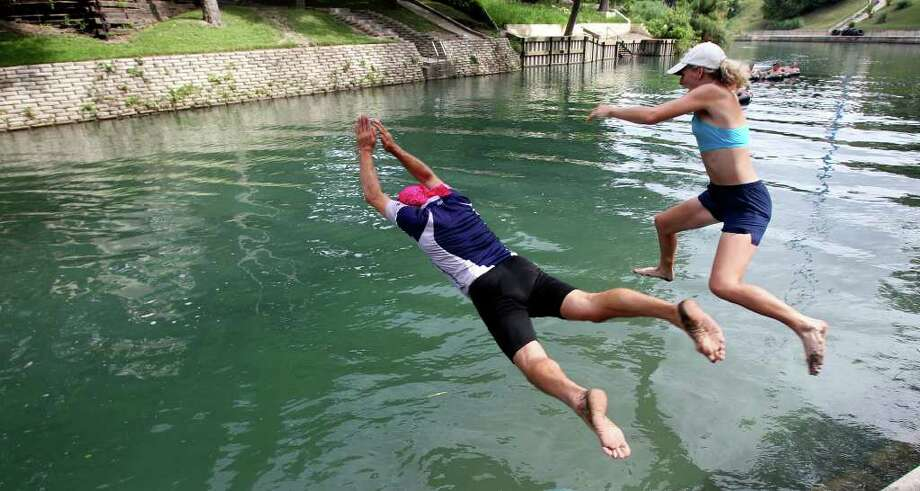 A pair of swimmers leap into the Comal River. (File photo) Photo: TOM REEL, SAN ANTONIO EXPRESS-NEWS / © 2010 San Antonio Express-News