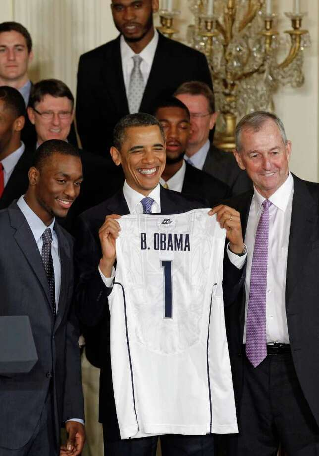 WASHINGTON, DC - MAY 16:  U.S. President Barack Obama (C) holds up a jersey while posing for photographs with 2011 NCAA Champion University of Connecticut men's basketball coach Jim Calhoun (R) and team guard Kemba Walker at the White House May 16, 2011 in Washington, DC. UConn earned the national championship with an 11-game run through the postseason, ending with a 53-41 win over Butler in the NCAA title game.  (Photo by Chip Somodevilla/Getty Images) Photo: Chip Somodevilla, Getty Images / 2011 Getty Images