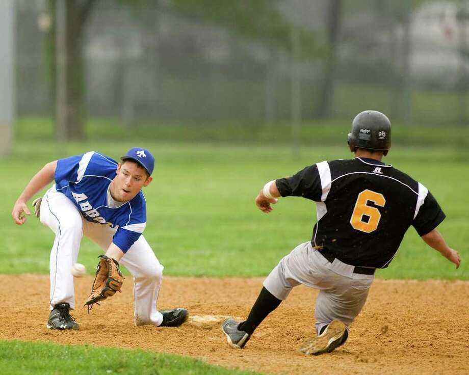 Abbott Tech shortstop Alex Johnson has the throw from catcher Gary Braun in time to catch Kaynor Tech's Joshua Mont stealing Monday at Rogers Park. Photo: Barry Horn / The News-Times Freelance