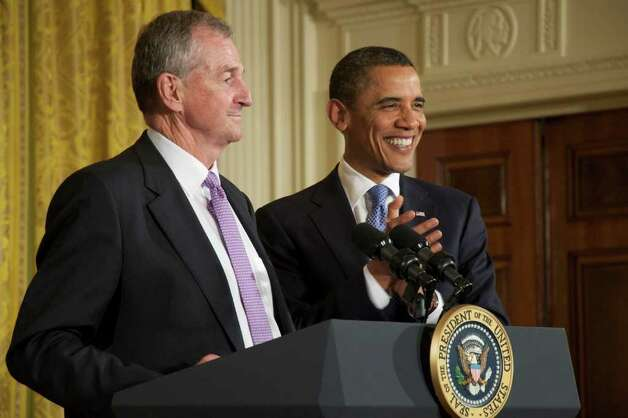 President Barack Obama commends University of Connecticut basketball's Head Coach Jim Calhoun on his 2011 NCAA National Championship on May 16, 2011 at the White House. Photo: Sarah Tung / Hearst Newspapers