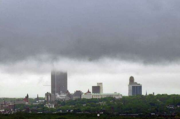 The Corning Tower is partially shrouded in fog on a rainy day as seen from Prospect Park in Troy on Monday, May 16, 2011.   ( Philip Kamrass / Times Union) Photo: Philip Kamrass