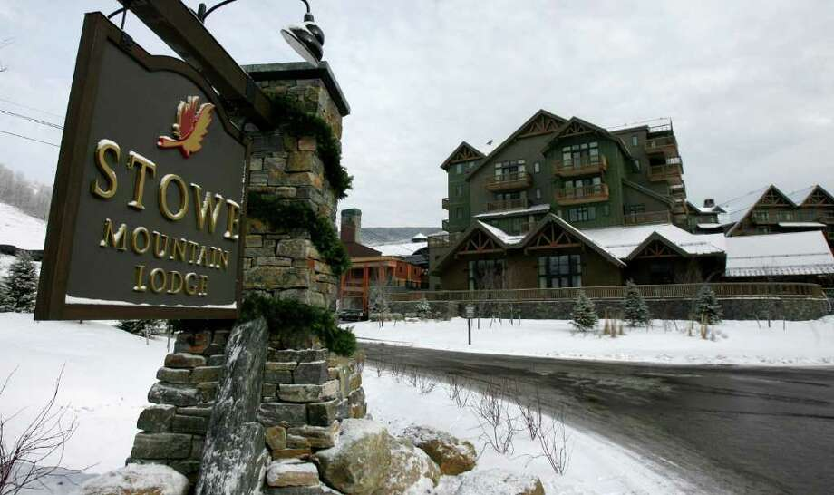 This Dec. 11, 2008, file photo displays the Stowe Mountain Lodge in Stowe, Vt. About 300 condo owners at the resort, including a Greenwich man, filed suit May 13, 2011 in U.S. District Court in Burlington against affiliates of American International Group (AIG), which owns the resort. Owners maintain they put down 20 percent deposits on their units in 2005, but when changes in the fees came just before closing in 2008, they say they weren't given an opportunity to back out. (AP Photo/Toby Talbot, File) Photo: Toby Talbot, AP / AP
