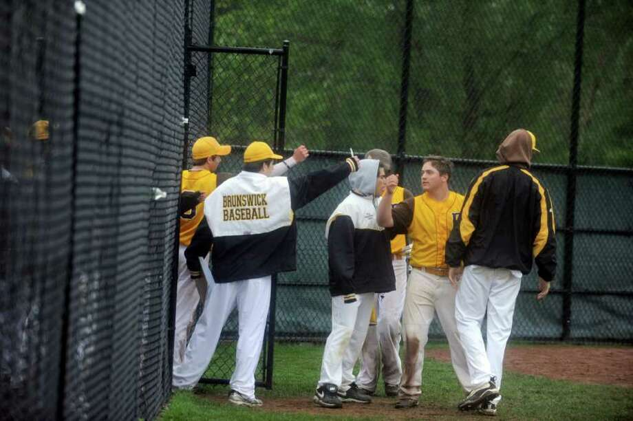 Brunswick School baseball team celebrates a win in the quarterfinals against Greens Farms Academy at Brunswick on Monday, May 16, 2011. Photo: Helen Neafsey / Greenwich Time