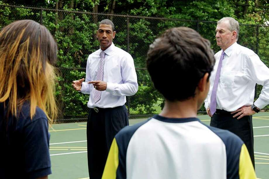 UConn. Head Coach Jim Calhoun and Assistant Coach Kevin Ollie give a pep-talk to students from Eliot-Hine Middle School at the White House South Lawn on May 16, 2011. Photo: Sarah Tung / Hearst Newspapers