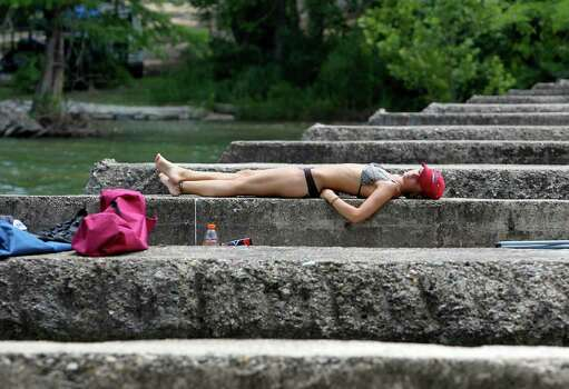 Concrete walls supporting a bridge provide a good spot for a sunbather on the Guadalupe River  on Friday, May 28, 2010.  Tom Reel/Staff Photo: TOM REEL, SAN ANTONIO EXPRESS-NEWS / © 2010 San Antonio Express-News