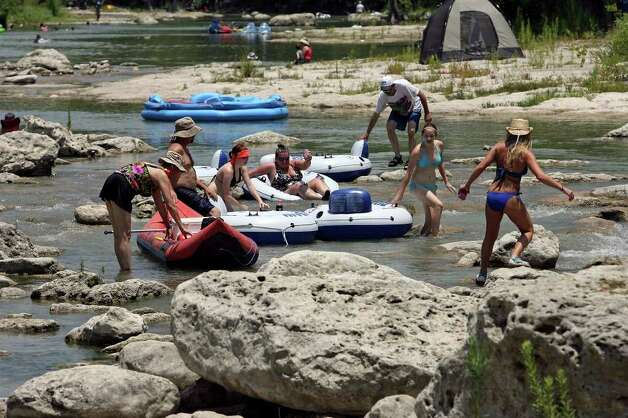 METRO   Tubers negotiate exposed rocks at Huaco Falls Saturday on the Guadalupe River.    June 27, 2009.   Tom Reel/Staff Photo: TOM REEL, Tom Reel/Express-News / treel@express-news.net