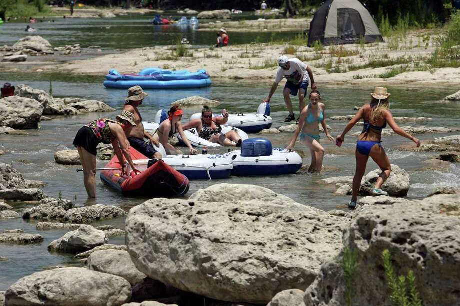 Tubers negotiate exposed rocks at Huaco Falls Saturday on the Guadalupe River.    June 27, 2009.   Tom Reel/Staff Photo: TOM REEL, Tom Reel/Express-News / treel@express-news.net