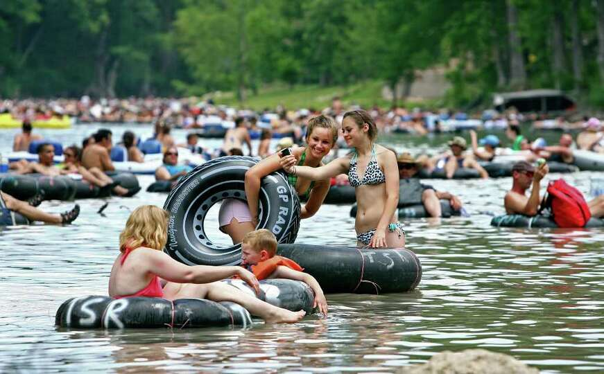 Despite cloudy skies and low water level, tubers pack into the horse shoe area of the Guadalupe Rive