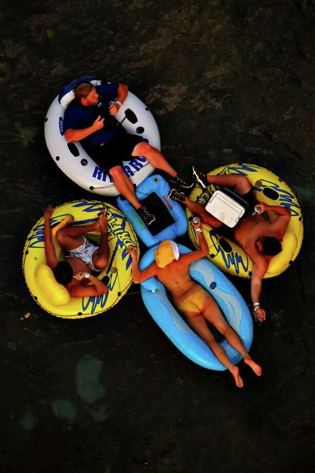 People tube on the Comal River in New Braunfels,  Saturday, May 24, 2008.  Photo: NICOLE FRUGE, SAN ANTONIO EXPRESS-NEWS / nfruge@express-news.net