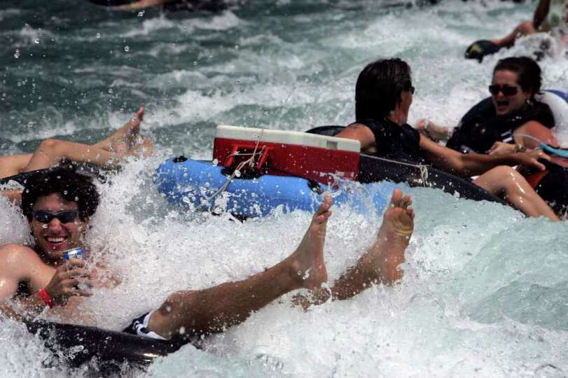 Tubers come off the City Tube Chute on the Comal River in New Braunfels on Sunday, September, 2, 200