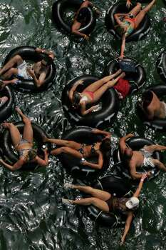 Tubers float on the Comal River near the City Tube Chute in New Braunfels on Sunday, September, 2, 2007.  Photo: LISA KRANTZ, SAN ANTONIO EXPRESS-NEWS / SAN ANTONIO EXPRESS-NEWS