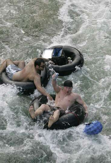 Tubers enjoy the Guadalupe River in New Braunfels, Texas on Saturday, May 19, 2007.